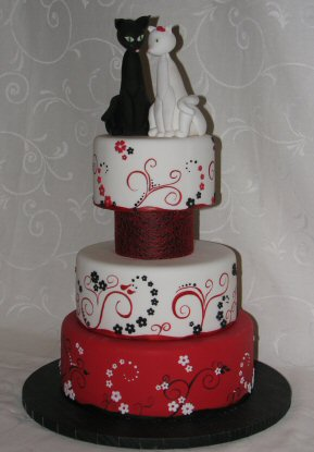 modern red black and white cake with cats