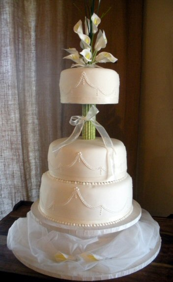 Modern three tier wedding cake  lilies at Boomrock