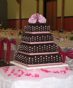 4 tier chocolate and pink wedding cake